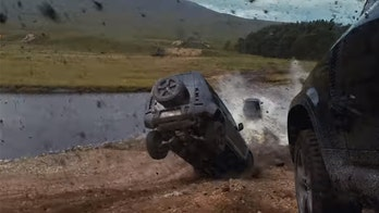 'No Time to Die' stunt team jumps and rolls new Land Rover Defender for James Bond film