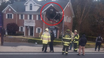 Porsche launches into New Jersey building's second floor leaving 2 dead, police say