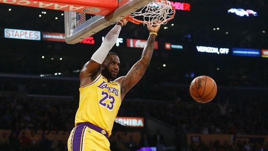 LeBron sets triple-double mark, Lakers hold off OKC 112-107