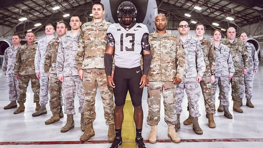 Oklahoma State football team honors veterans with military style uniforms