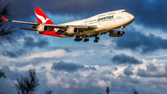 Qantas passengers stuck in sweltering heat for hours after being diverted to military base