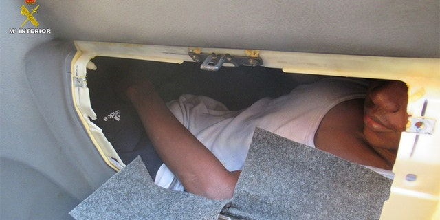A 17-year-old migrant was found hiding in the glove compartment of a Hyundai station wagon.