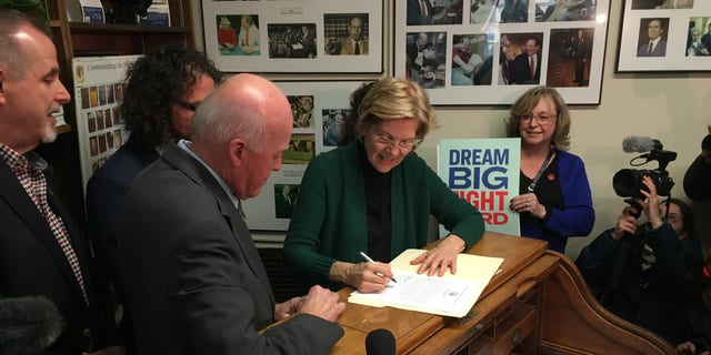 Sen. Elizabeth Warren of Massachusetts files to place her name on a New Hampshire primary list in Concord Wednesday.