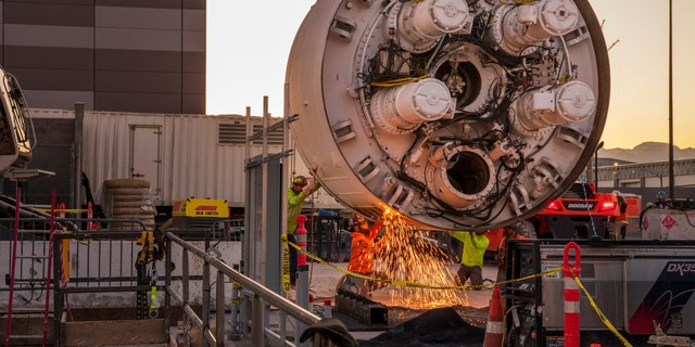 Workers cut the storage rack from the base of the boring head as the Boring company prepares to lower the drill head for the People Mover Tunnels that connect the convention halls as part of the LVCCD Phase 2 construction in the Red lot East of the South Hall at the Las Vegas Convention center on Monday, Oct. 28, 2019.