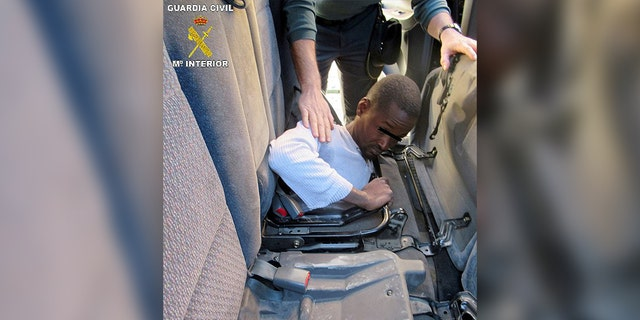 One of the migrants, a 19-year-old, was found hiding under the rear car seats.