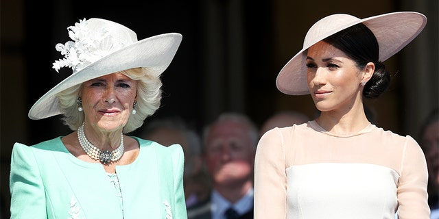 Camilla, Duchess of Cornwall and Meghan, Duchess of Sussex attend The Prince of Wales' 70th Birthday Patronage Celebration held at Buckingham Palace on May 22, 2018, in London, England.