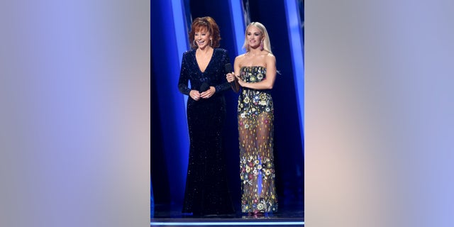 Reba McEntire and Carrie Underwood onstage during the CMA Awards. (Photo by Terry Wyatt/Getty Images,)