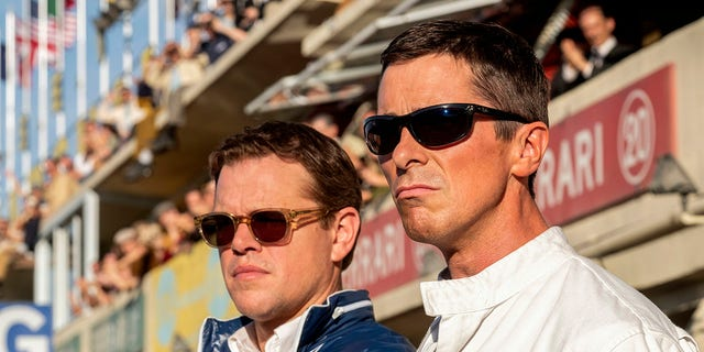 "This image released by 20th Century Fox shows Christian Bale, right, and Matt Damon in a scene from the film, ""Ford v. Ferrari."""