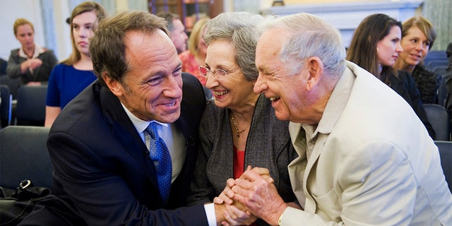 "Mike Rowe, left, producer and host of Discovery Channel's ""Dirty Jobs,"" shares a laugh with his parents John and Peggy Rowe, of Perry Hall, Md., before Mike testified at a Senate Commerce, Science, and Transportation Committee hearing in Russell Building entitled ""Manufacturing Our Way to a Stronger Economy."""
