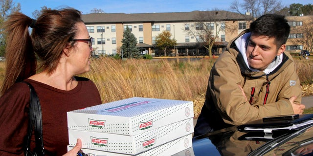 The student, who charged $17 to $20 per box of 12 doughnuts and had some customers pay $100 per run, was reportedly told his side gig was a liability for Krispy Kreme.