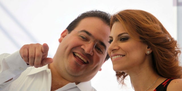 US News In this Jan. 7, 2011, photo, former Veracruz Gov. Javier Duarte and wife Karime Macias. (AP Photo/Felix Marquez)