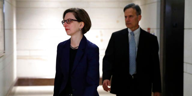 Deputy Assistant Secretary of Defense Laura Cooper, left, arrives to review her testimony as part of the House impeachment inquiry into President Donald Trump, Wednesday, Oct. 30, 2019, on Capitol Hill in Washington. (AP Photo/Patrick Semansky)