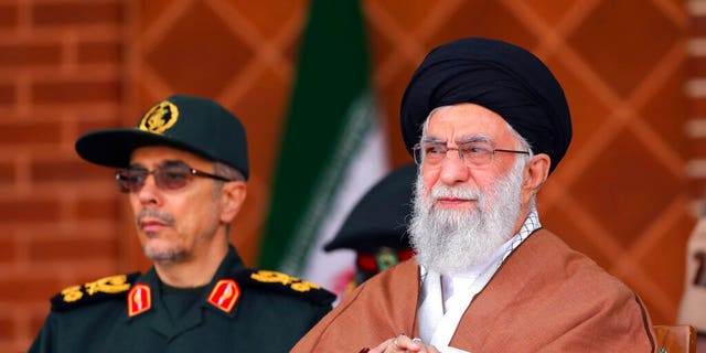 Supreme Leader Ayatollah Ali Khamenei reviews armed forces with Chief of the General Staff of the Armed Forces Gen. Mohammad Hossein Bagheri, during a graduation ceremony at Iran's Air Defense Academy, in Tehran, Iran, Wednesday, Oct. 30, 2019.
