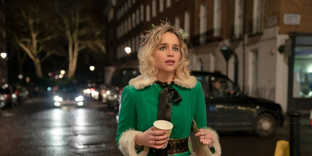 "This image released by Universal Pictures shows Emilia Clarke in a scene from ""Last Christmas."" (Jonathan Prime/Universal Pictures via AP)"