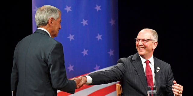 Republican candidate Eddie Rispone, left, shakes hands with Democratic Louisiana Gov. John Bel Edwards before a debate last month. (Associated Press)