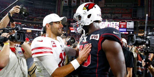 San Francisco 49ers quarterback Jimmy Garoppolo (10) greets Arizona Cardinals linebacker Chandler Jones (55) after an NFL football game, Thursday, Oct. 31, 2019, in Glendale, Ariz. The 49ers won 28-25.