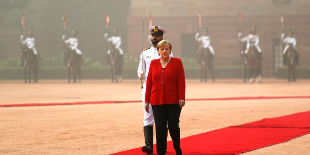 German Chancellor Angela Merkel inspects a joint military guard of honor during her ceremonial reception at the Indian presidential palace in New Delhi, India, Friday, Nov. 1, 2019. Merkel is on a three-day visit to India. (AP Photo/Manish Swarup)