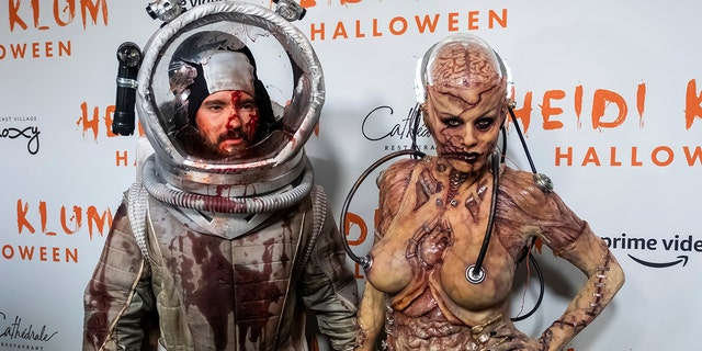 Tom Kaulitz, left, and Heidi Klum, right, in their costumes at her Halloween party at Cathedrale on Thursday, Oct. 31, 2019, in New York.