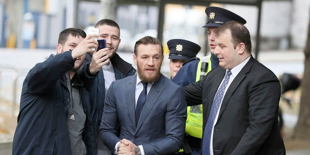 UFC fighter Conor McGregor arrives at the District Court where he pleaded guilty Friday to an assault charge after allegedly punching a man at a pub, in Dublin on Friday. (Brian Lawless/PA via AP)