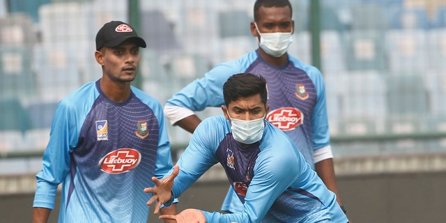 Bangladesh cricket team members wear masks to protect themselves from air pollution as they practice at the nets ahead of their first T20 international cricket match against India in New Delhi, India, Friday, Nov. 1, 2019.