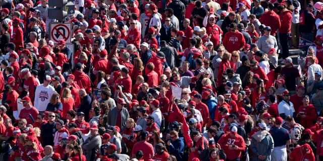 Fans wait for the start of the MLB Washington Nationals celebration of the team's World Series baseball championship over the Houston Astros, in Washington, Saturday, Nov. 2, 2019. The Washington Nationals are getting a hero's welcome home from a city that had been thirsting for a World Series championship for nearly a century.(AP Photo/Cliff Owen)