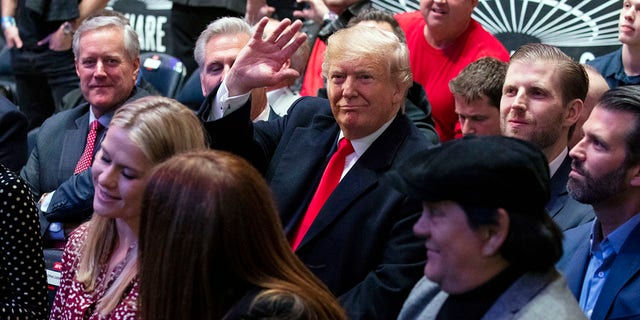 President Trump -- accompanied by (from left) Reps. Mark Meadows and Kevin McCarthy, and sons Eric and Donald Jr. -- ​waving at Madison Square Garden while attending the UFC 244 fights Saturday in New York City. (AP Photo/ Evan Vucci)