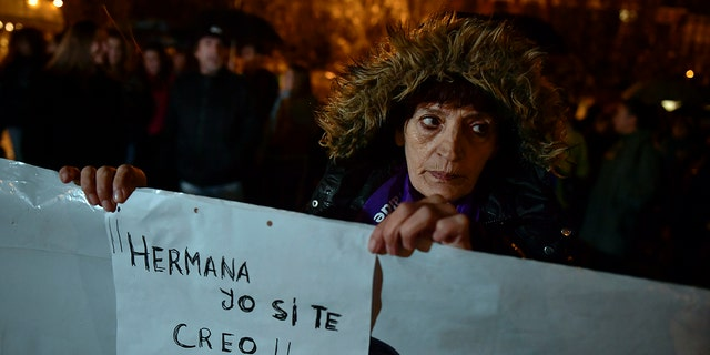 A woman holds a sign reading ''Sister. I believe you'' as people gather at Plaza del Castillo square to a protest against sex assault, in Pamplona, northern Spain, Monday, Nov. 4, 2019. (AP Photo/Alvaro Barrientos)