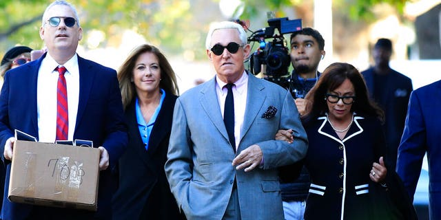 Roger Stone, with his wife, Nydia Stone, right, arrives at Washington D.C. federal court Tuesday. (AP Photo/Manuel Balce Ceneta)