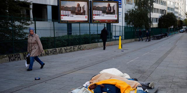 Homeless migrants sleep in the street in Paris, France, Wednesday, Nov. 6.