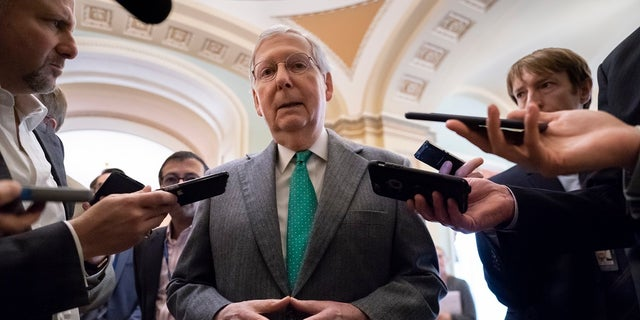 Senate Majority Leader Mitch McConnell, R-Ky., pauses outside the chamber to speak to reporters when asked about the race for Kentucky governor, at the Capitol in Washington, Wednesday, Nov. 6, 2019. (AP Photo/J. Scott Applewhite)