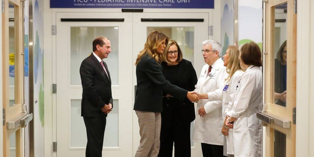 First lady Melania Trump greets hospital administrators in the Pediatric Intensive Care Unit at Boston Medical Center. Health and Human Services Secretary Alex Azar stands at left. (Associated Press)