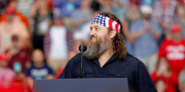 Willie Robertson, left, of the reality TV series 'Duck Dynasty,' addresses the crowd at a campaign rally for President Trump in Monroe, La., Wednesday, Nov. 6, 2019.