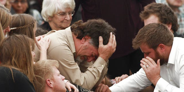 David Langford being consoled during the funeral service for his wife and sons in La Mora, Mexico, on Thursday.