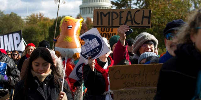Demonstrators marching on Pennsylvania Avenue protesting against climate policies and President Trump, in Washington last week. (AP Photo/Jose Luis Magana)