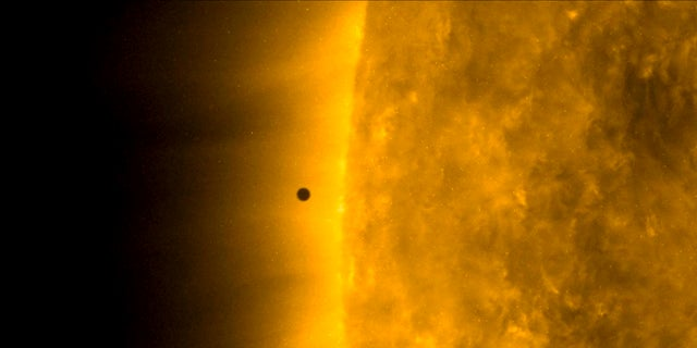 This still image from a video from NASA's Solar Dynamics Observatory shows Mercury walking the Earth between Monday and Sunday Sun wanders. The smallest, innermost planet of the solar system resembles a tiny black dot during transit that began at 7:35 EST (1205 UTC). (NASA Solar Dynamics Observatory via AP)