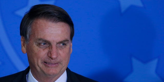 Brazil's President Jair Bolsonaro attends the launch of the Green and Yellow program to create formal jobs for young people earlier this month. (AP Photo/Eraldo Peres)