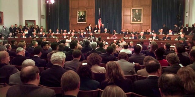 In this Nov. 19, 1998 file photo, House Judiciary Committee Chairman Henry Hyde, R-Ill., presided over the committee's impeachment hearing for President Clinton. (AP Photo/Joe Marquette, File)