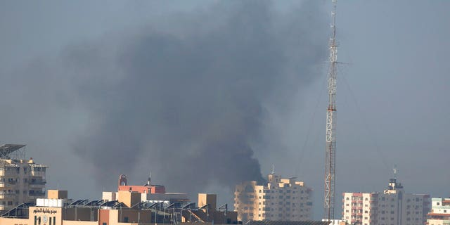 Nov. 12: Smoke rises after an Israeli forces strike in Gaza City. Israel killed a senior Islamic Jihad commander in Gaza early Tuesday in a resumption of pinpointed targeting that threatens a fierce round of cross-border violence with Palestinian militants. (AP Photo/Hatem Moussa)
