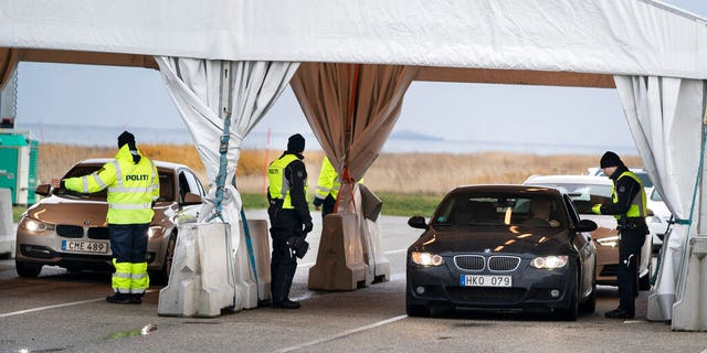 US News Danish police check travellers from Sweden, near the Highway coming out of the Tunnel near Copenhagen, Denmark.