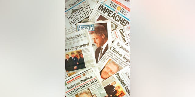 The Dec. 20, 1998 editions of newspapers from Massachusetts and Rhode Island with headlines of President Clinton's impeachment. (AP Photo/Peter Lennihan, File)