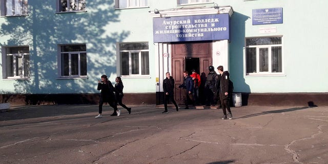 In this photo provided by Vera Zaderko, students leave a college after a shooting in Blagoveshchensk, Russia, Thursday, Nov. 14, 2019. (Associated Press)