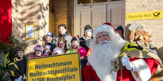 As part of the annual event organized by Germany's Deutsche Post, Santa and 20 helpers last year responded to 277,200 letters from 64 countries. (Soeren Stache/dpa via AP)