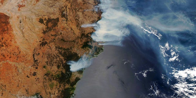 This NASA Modis satellite image provided by Maxar shows smoke from wildfires burning in New South Wales, Australia, Thursday, Nov. 14, 2019.