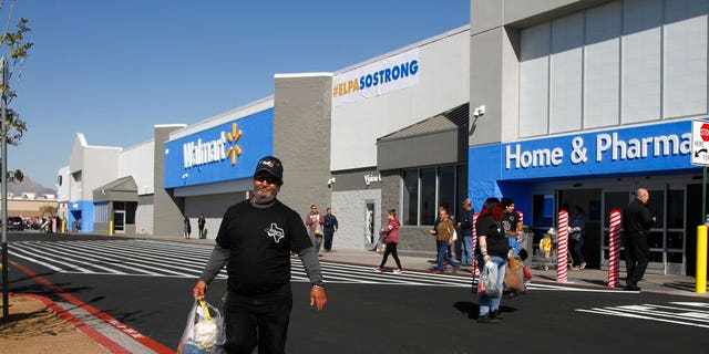 62-year-old Eddie Medina carries groceries purchased by his wife at the reopening of the Cielo Vista Walmart, Thursday, November 14, 2019, in El Paso, Texas.
