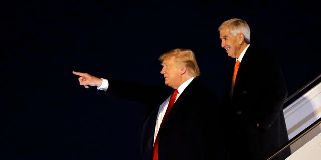 President Donald Trump arriving at Barksdale Air Force Base, La., with Republican gubernatorial candidate Eddie Rispone. (AP Photo/ Evan Vucci)
