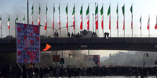 Smoke rises during a protest in the city of Isfahan on Saturday. (AP Photo)