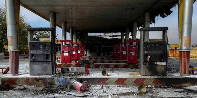 A gas station that was burned during protests that followed officials' decision to raise gasoline prices, in Tehran, Iran.