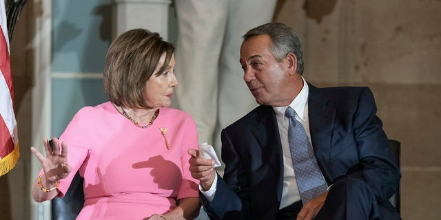 House Speaker Nancy Pelosi, D-Calif., and former House Speaker John Boehner speak during a ceremony to unveil a portrait honoring Boehner on Capitol Hill, on Tuesday in Washington. (AP Photo/Michael A. McCoy)