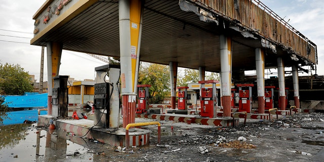 A gas station shows damages after it was attacked and burned during protests over rises in government-set gasoline prices, in Tehran, Iran, Wednesday, Nov. 20, 2019. Demonstrations struck at least 100 cities and towns, spiraling into violence that saw banks, stores and police stations attacked and burned.