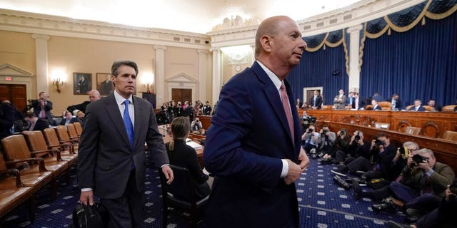 U.S. Ambassador to the European Union Gordon Sondland, followed at left by attorney James McDermott, finishes a day of testimony before the House Intelligence Committee on Capitol Hill in Washington, Wednesday, Nov. 20, 2019, during a public impeachment hearing of President Donald Trump's efforts to tie U.S. aid for Ukraine to investigations of his political opponents.